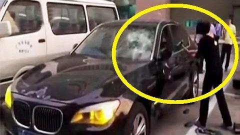 VIDEO: Petetud naine peksab mehe 200 000 naela maksva BMW puruks